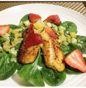 My homemade broiled tilapia salad in salsa sauce with pinapple and strawberries.